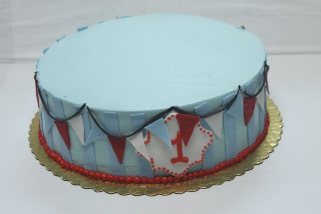 "10"" cake with stripes, pennants and #1"