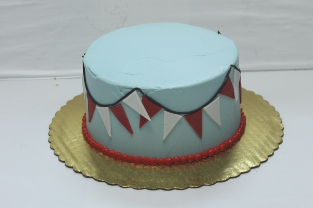 "6"" cake with pennants"