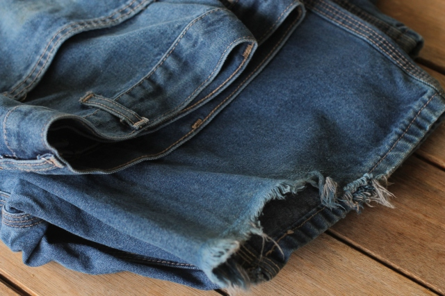 from tattered jeans